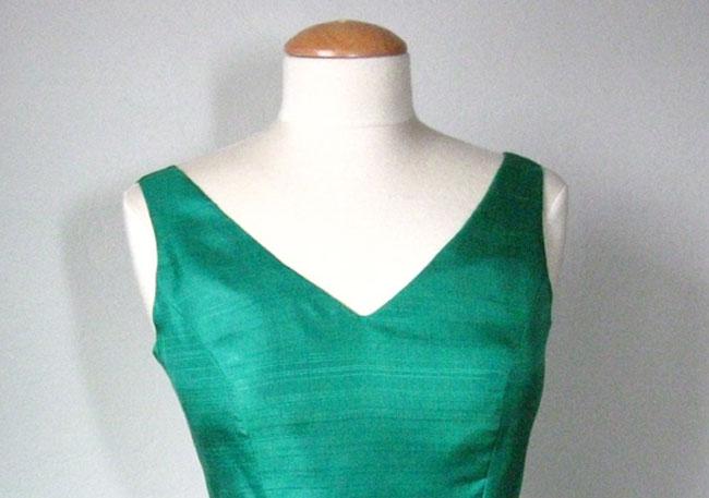 Green silk dress with V-neckline