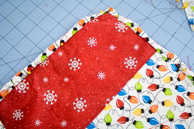 Fold binding to back of placemat