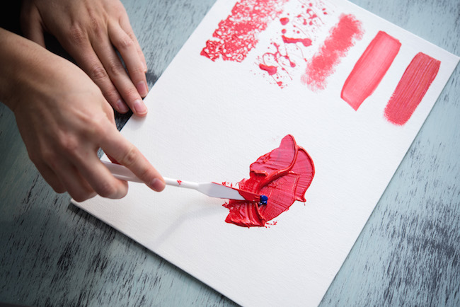 Applying Red Acrylic Paint With a Palette Knife