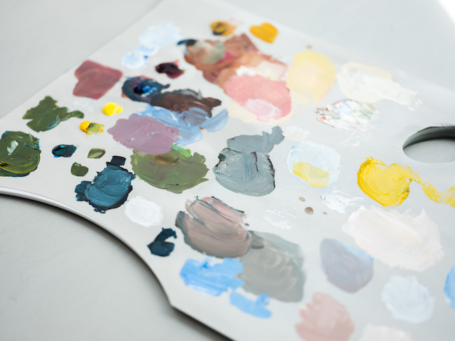 Gray Plastic Palette with Acrylic Paint Splotches
