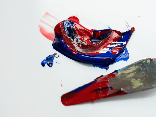 Red and Blue Acrylic Paint Partially Mixed with Palette Knife