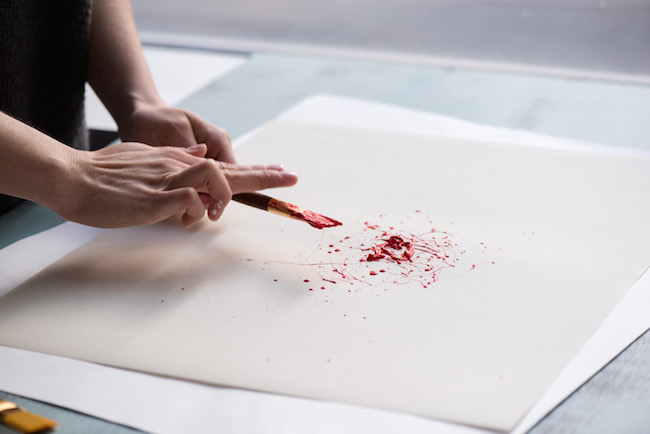 Splattering Red Acrylic Paint on Paper