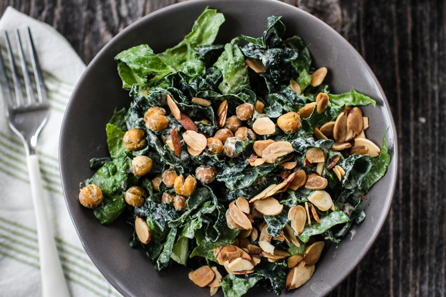 Vegan caesar salad with kale and nuts