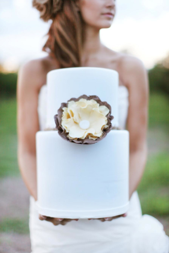 Bride Holding Cake with Large Flower: How to Make Sugar Flowers