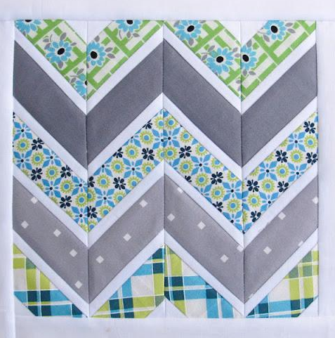 Blue and Grey-Toned Quilt with Chevron Pattern