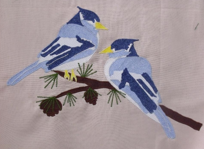 Quilt Featuring Two Birds on a Branch