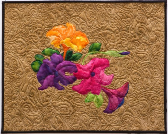 Brown Quilt Featuring Bright Floral Design