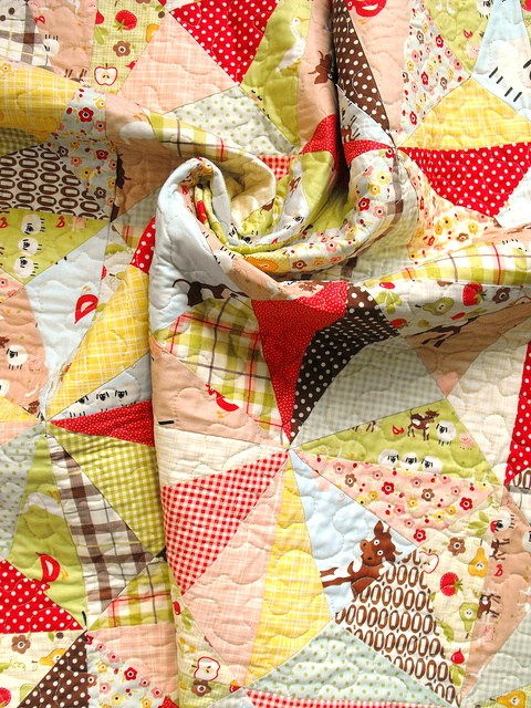 Quilt Created of Patterned Triangle Design