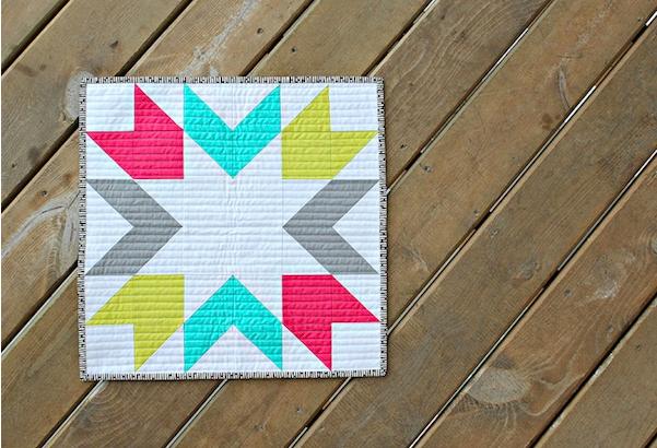 starburst mini quilt on wood background