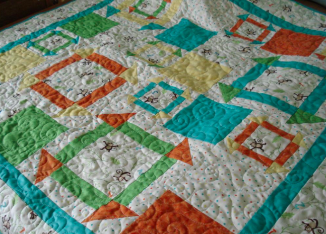 monkey quilt pattern featuring free motion quilting, on Craftsy