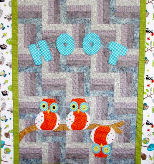 hoot quilt featuring cute, patterned owls