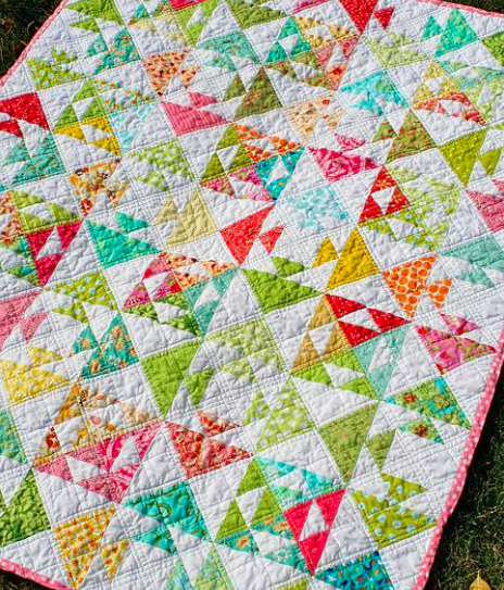 pieced fish quilt featuring flying geese design