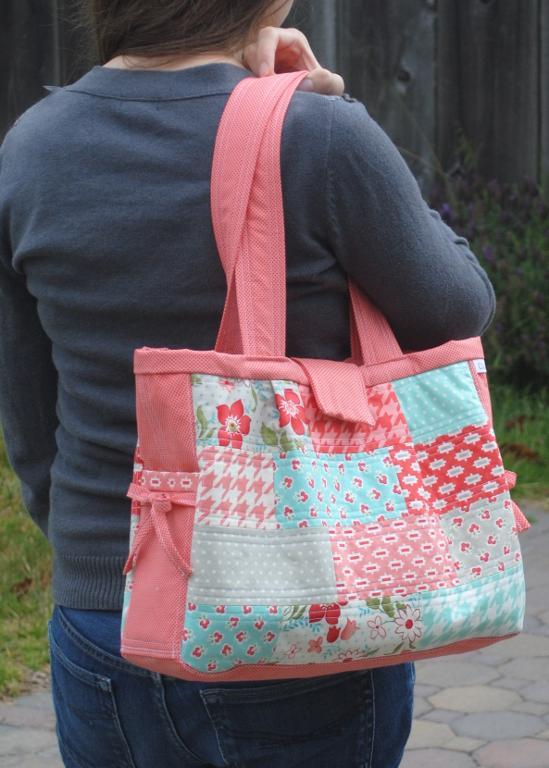 Pink and Pastel Quilted Bag on Woman's Shoulder