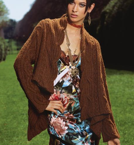Woman Modeling Brown Cable Sweater in Natural Setting