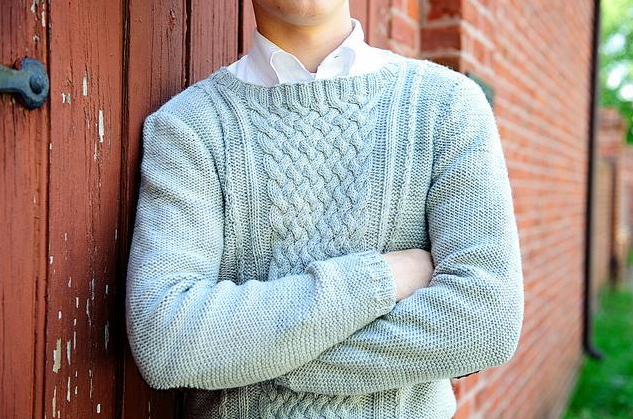Man Modeling Light Blue Cable Sweater Against Barn