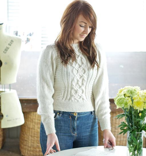 Woman Wearing White Cable Sweater