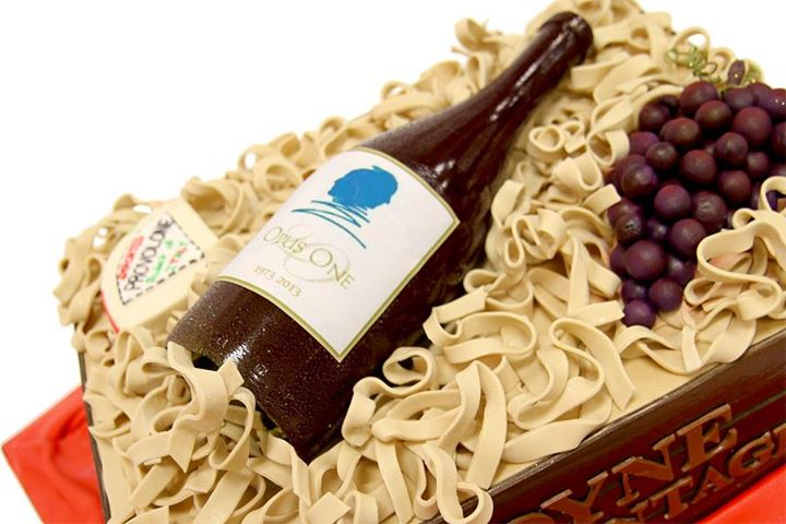 Cake in Shape of Wine Bottle with Cheese and Grapes