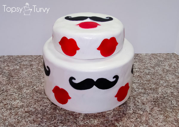 White Tiered Cake with Painted Lips and Mustaches