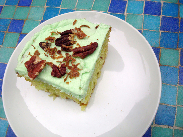 Slice of Cake with Green Icing and Pecans, Mosaic Tile Background