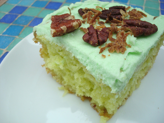 slice of Yellow Cake with Green Icing, Pecans on Top