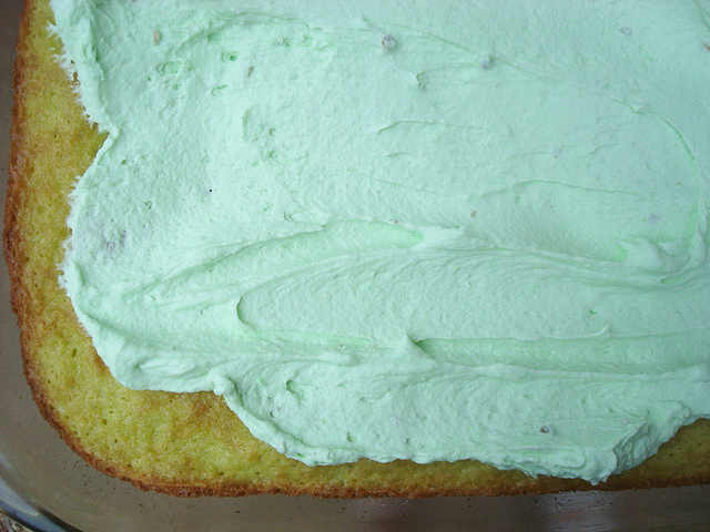 Closeup of Green Icing Being Spread on Cake