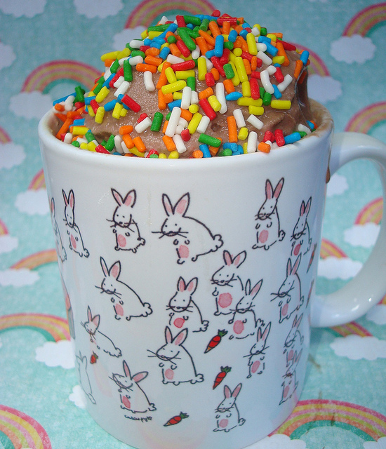 Cake in Bunny Mug Topped with Chocolate Ice Cream and Sprinkles