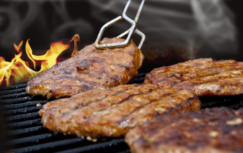 Meat on Flaming Barbecue Grill