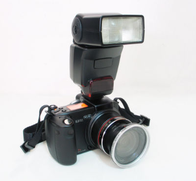 Camera with Speedlight Attached On Top