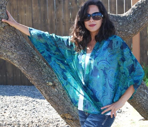 Woman in Sunglasses Modeling Blue Garment Against Tree