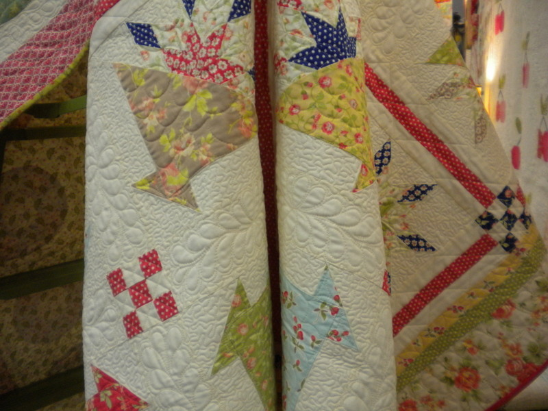 Hanging, Draping Quilt Featuring Colorful Baskets