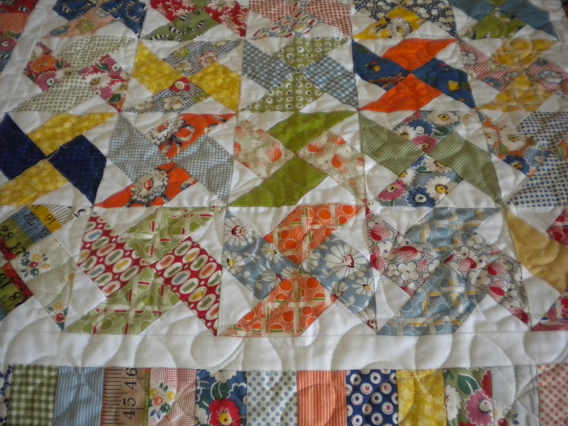 Quilt with Colorful Pinwheel Patterns