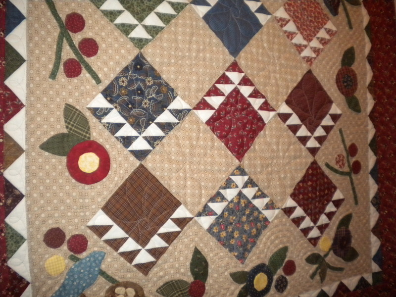 Muted Quilt with Diamond and Fruit Design