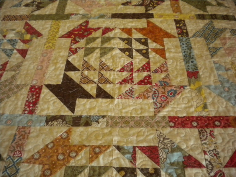 Creative Quilt with Colorful Patterned Triangles