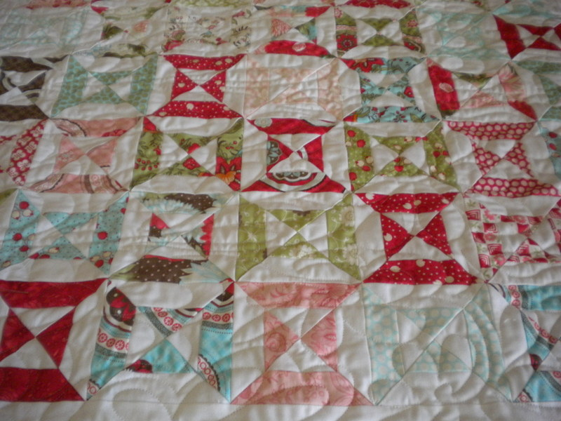Short Story Quilt Decorated with Quarter-Square Triangles