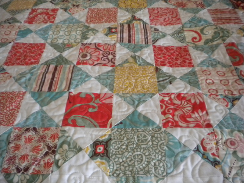 "The ""Schnibbles Quilt"" with Patterned Squares and Triangles"