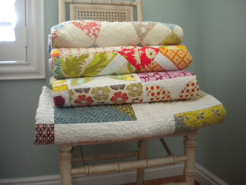 Folded Quilts Stacked on a Chair