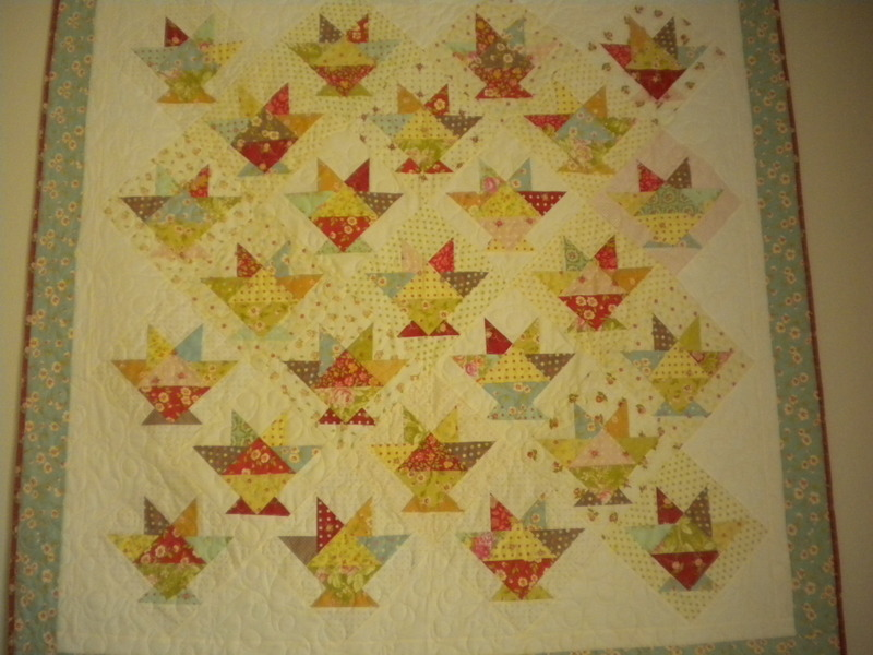 Quilt with Many Colorfully Patterned Baskets
