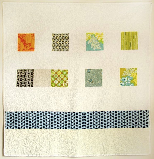 Beige Quilt with Patterned Squares