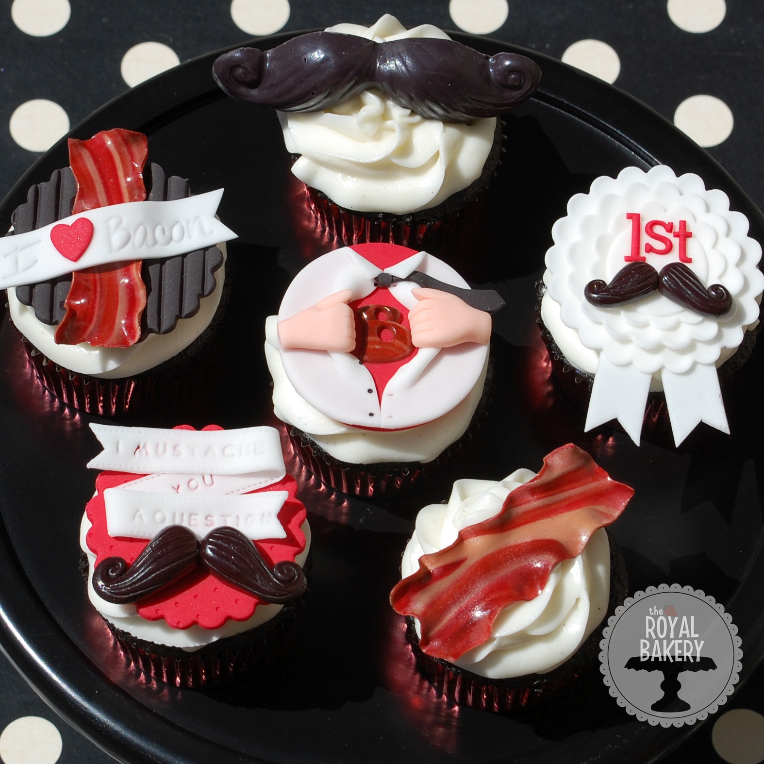 Series of Cupcakes with Red, Black, and White Shiny Tops