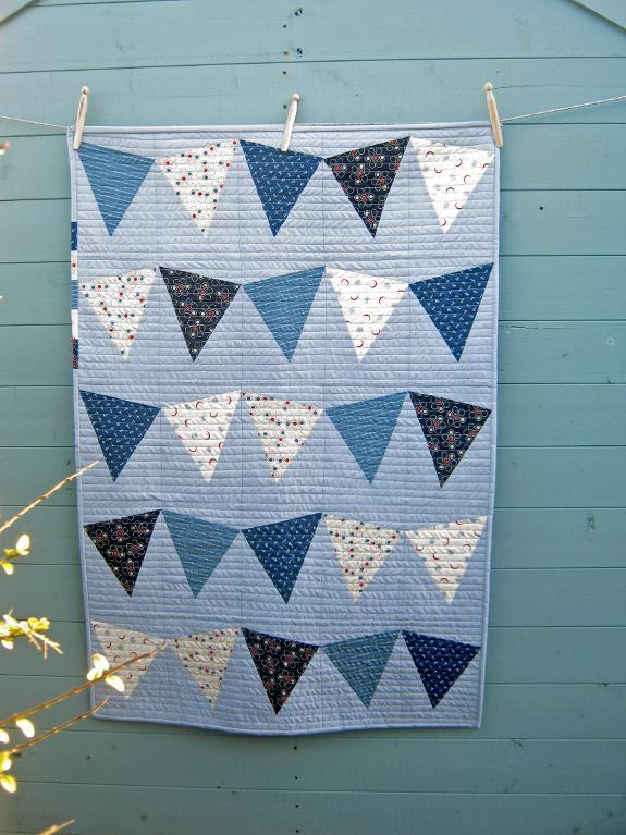 Blue Quilt with Triangle Designs