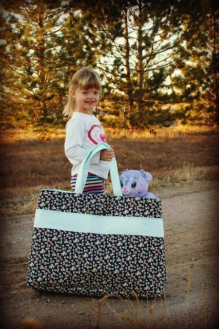 Little Girl Carrying Tote Bag with Stuffed Animal