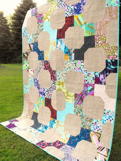 Photo of Colorful Fussy Cut Quilt Against Natural Background