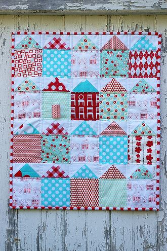 Patterned House Quilt Hanging Against a House