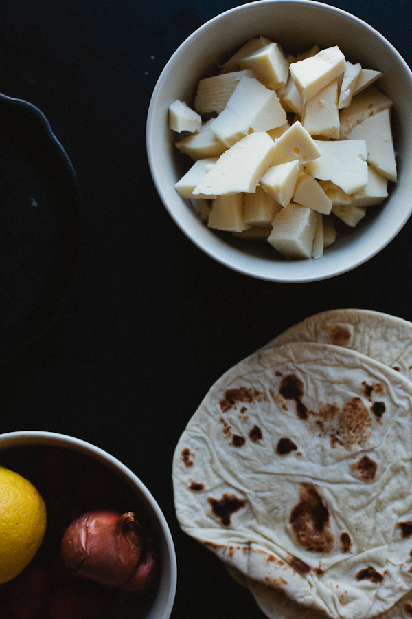 Bowl of Sliced Cheese, Tortillas, Onion and Lemon