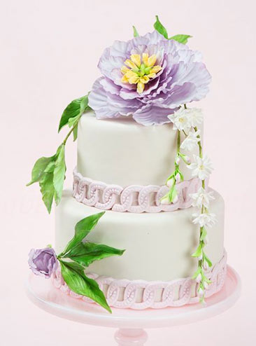 Tiered Cake Topped with Flower and Vines