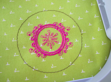 Pink Embroidery Design on Green Fabric