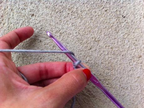 Woman's Hands Beginning a Crochet Chain