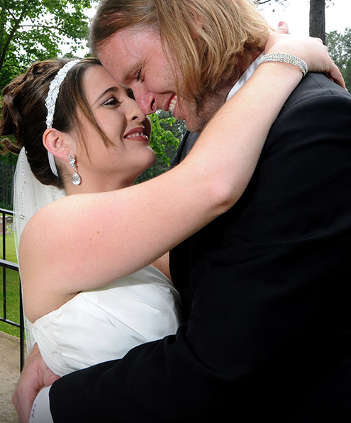 Bride and Groom Smiling at One Another