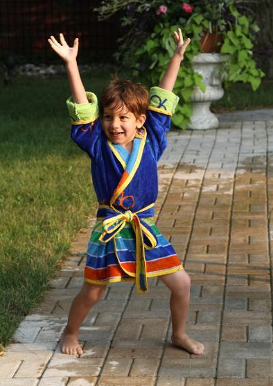 Little Boy Acting Silly in Bright Blue Robe