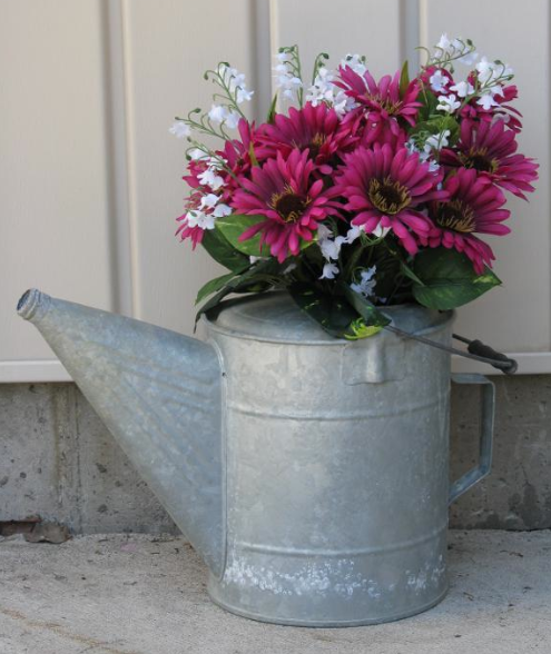 Metal Watering Can wiht Pink and White Flowers Inside